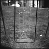 Chained Playgrounds, 2016. Orwo 25 black & white film. Site-specific interventions - iron chains on broken cradles.